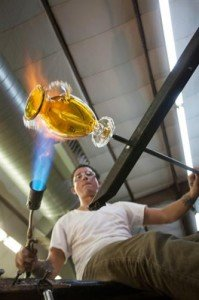 man working at glass studio